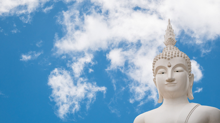 Old buddha statue on Clouds and blue sky background