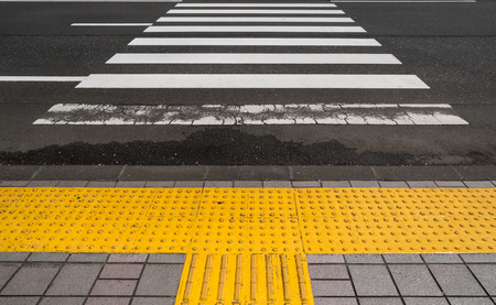 Footbaths and braille block side crossing the road Stock Photo