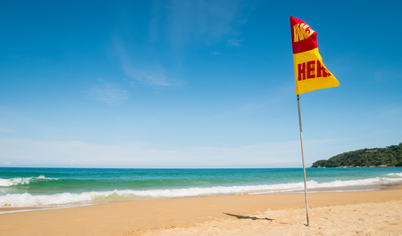 A word Swin Here on the red and yellow flags on the beach.To tell the point safe for swimming In security concept