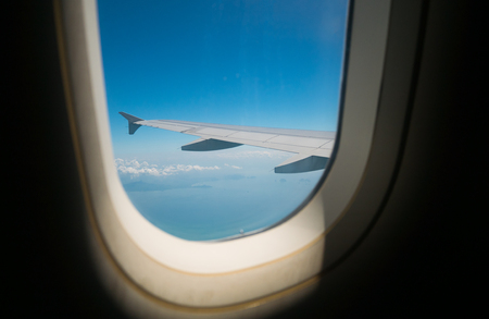 View of plane windows In the fly over the sky in  transportation concept 写真素材