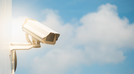 CCTV camera in security system in urban city with sky background in security concept,Soft focus with sun light 写真素材