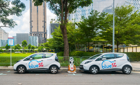 SINGAPORE MAR 2018 : Electric car parking at charging station  in car sharing concept 報道画像