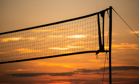 silhouette Volleyball net with sunset background