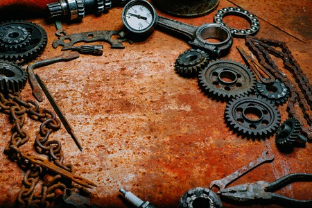Motorcycle tools, equipment and repair, old chain, tools on vintage metal background