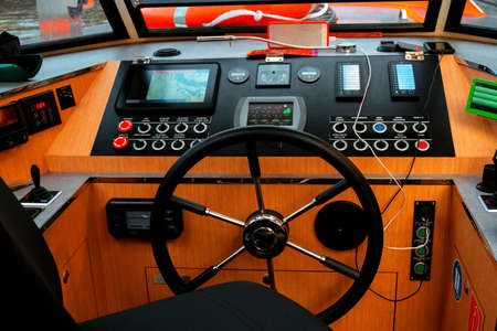 Amsterdam, Netherlands - june 2019. steering wheel and control panel for a pleasure boat