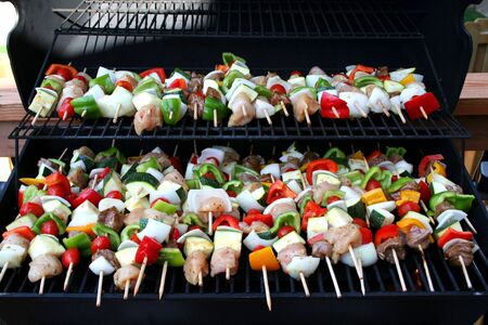 barbecue full of kabobs cooking quickly Stock Photo