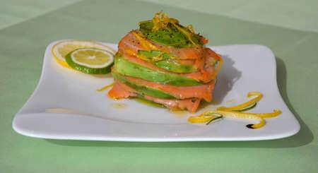unusually: Unusually styled slices of fresh salmon with avocado Stock Photo