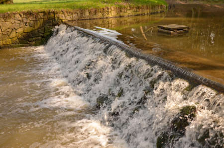 weir: Small stream cascading over a weir, Pruhonice castle park, Czech republic