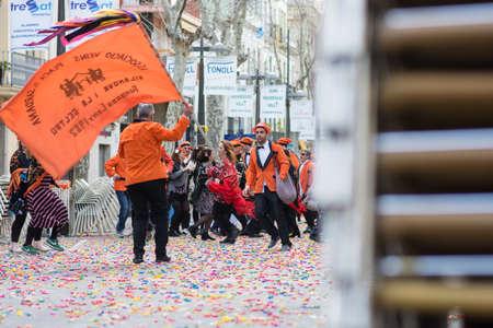 Vilanova i la Geltrú  Spain - February, 11, 2018: Comparsas groups dancing in War of candies Editorial