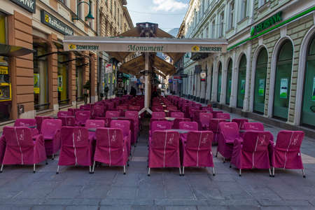 bosnia and hercegovina: Bunch of pink restaurant chairs in Sarajevo pedestrian zone
