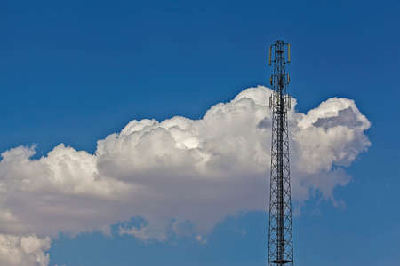antennas: Antennas for mobile telephony in the clouds Stock Photo