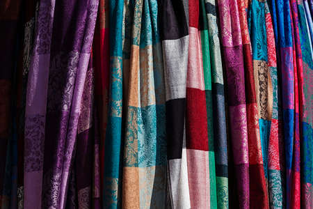 sciarpe: Colorful shawls and scarves in the market