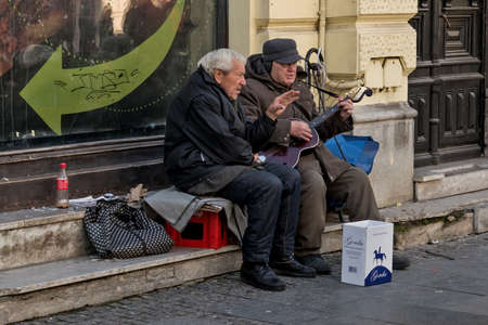 retirees: Belgrade, Serbia - February 27, 2016: Two retirees playing guitar and singing on the street