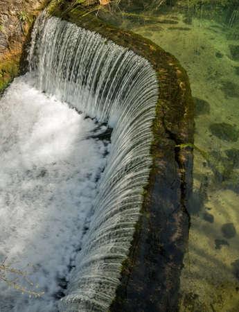 semicircular: Semicircular dam with small lake that cause waterfall 01