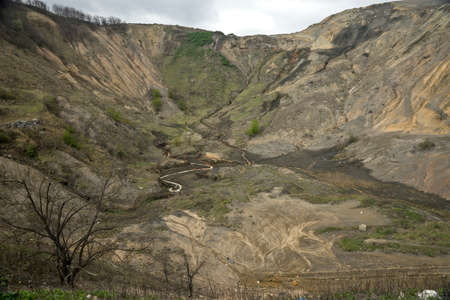 tailings: The artificial hill created from tailings in the exploitation of copper ore Stock Photo
