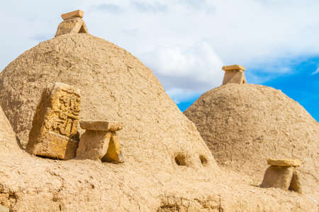 Photo is taken in Harran, Sanliurfa Turkey. This is the photo of the typical Harran house. Houses is made of mudbrick. Door and small windows can be seen too. Conic shaped and mudbrick and conic roofs are special to Harran area. Some special tool are hang