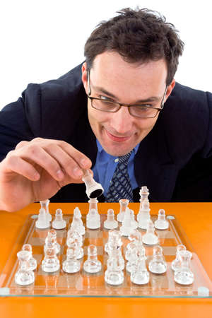 Chessman playing checkmate on glass board Stock Photo