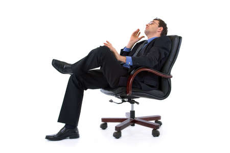 Handsome businessman thinking or dreaming on armchair