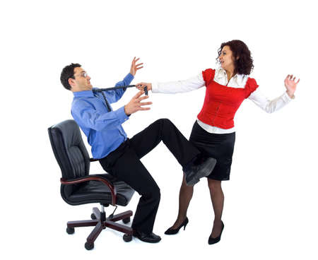 Beautiful secretary woman wresting businessman from armchair by tie Stock Photo