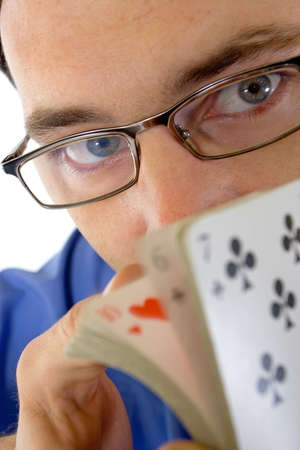 Portrait of young man shuffling cards in foreground