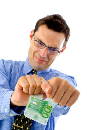 Angry businessman tearing money in two in foreground Stock Photo