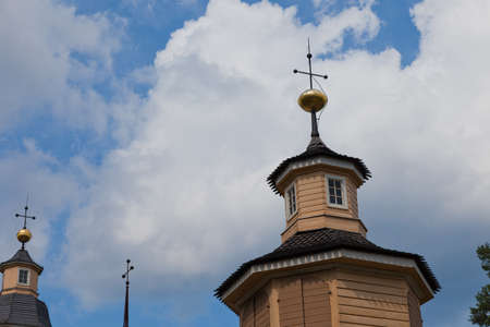 Old yellow chruch and blue sky photo