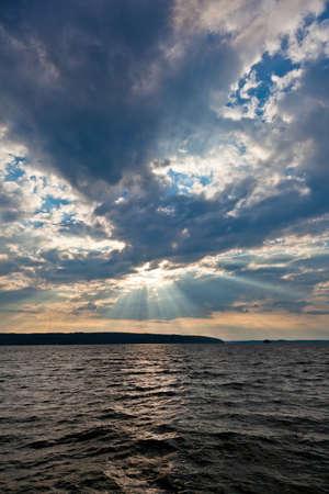 thru: Sun shining thru clouds