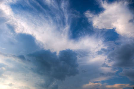 every: Raining clouds with rays of light shining through Stock Photo