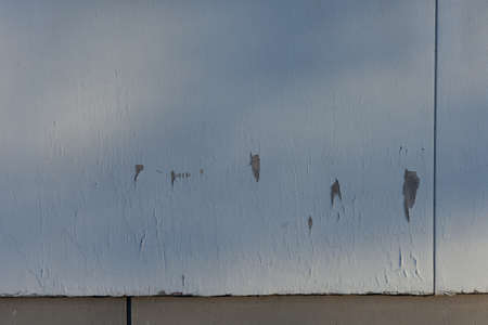 Wooden exterior wall with deteriorating white paint Stock Photo - 13054494