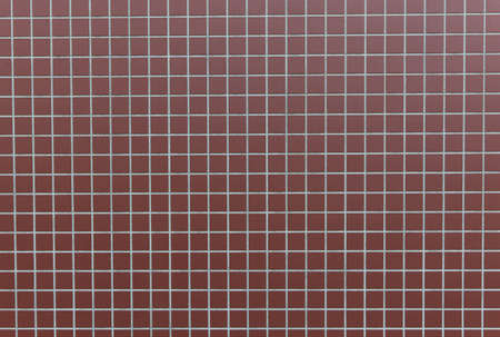 Square reddish tiles on a exterior wall photo