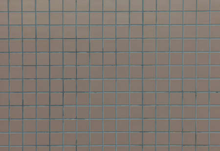 Square beige tiles on a exterior wall Stock Photo - 13054487