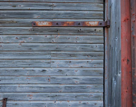 Old barn wall with rusted hinge photo