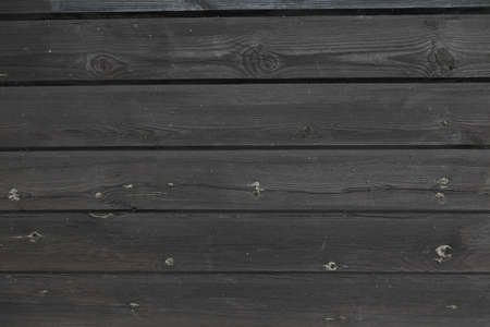 Black plank wall with sap photo