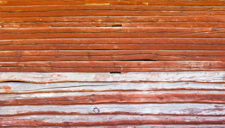 Red wall of an log cabin photo