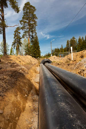 gravel roads: New district heating pipes laid on the ground Stock Photo