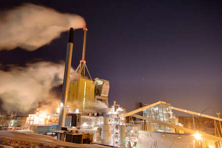 Kymij�rvi power plant on a clear windy winter night photo