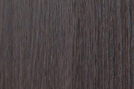upright: Upright dark oak veneer surface with dark notches