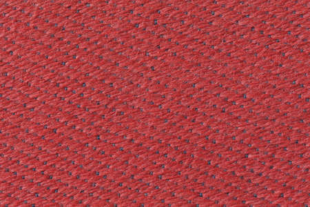 upholster: Red plastic braid furniture cover with blue knots Stock Photo