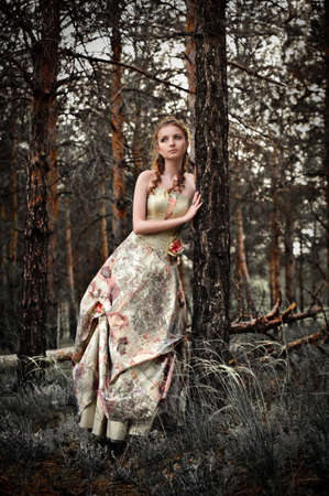 Portrait of romantic woman in fairy forest photo