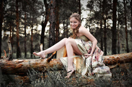Portrait of romantic woman in fairy forest Stock Photo - 9001668