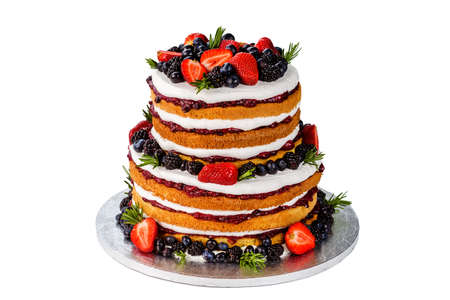 Low-calorie gluten-free cake with strawberries, blackberries and blueberries on an isolated background
