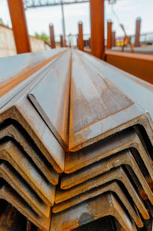 Metal profile angle in packs at the warehouse of metal products.