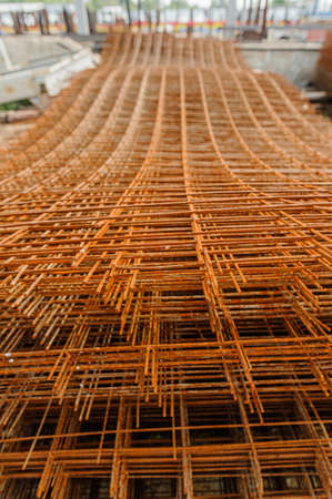 Rusty fittings. rusty construction metal mesh. Rusty Metal armature net for building construction. metal rebar for construction