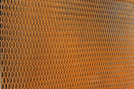Background close up of rusty steel metal grating net texture structured design. For photo collages