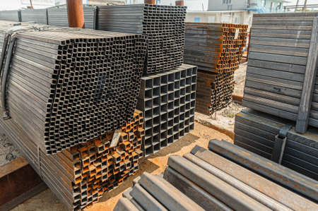 Metal square pipes in stock. Stacks of new square steel pipes at the factory.