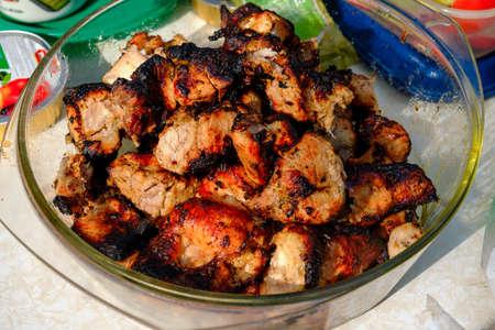 Ready-made shish kebab in a plate, close-up