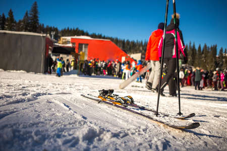 Close-up view of the berths on the skis. The skis are on the ski slope and the weather is beautiful and the day is sunny. Copy Space. Skiing. Stock fotó