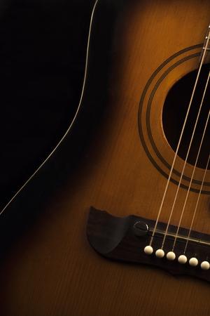 Guitar in color on black background Banco de Imagens