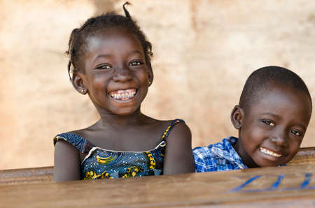 Happiness Symbol: Couple of African Children Laughing at School 写真素材