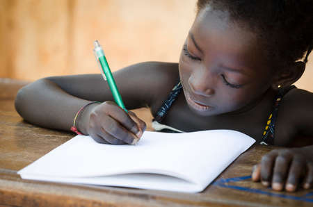 Schooling symbol - African Young Girl Writing Notes (Real People)